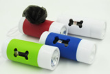 Dog waste bag dispenser with light